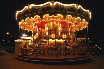 Brightly illuminated traditional carousel in Paris France at night